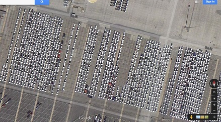 Aerial of car inventory lots thousands of cars unsold no place to go
